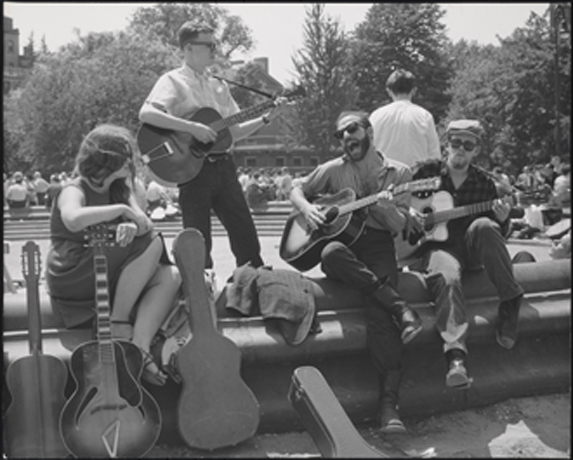 Bearded guitarist with other musicians, Washington Square Park