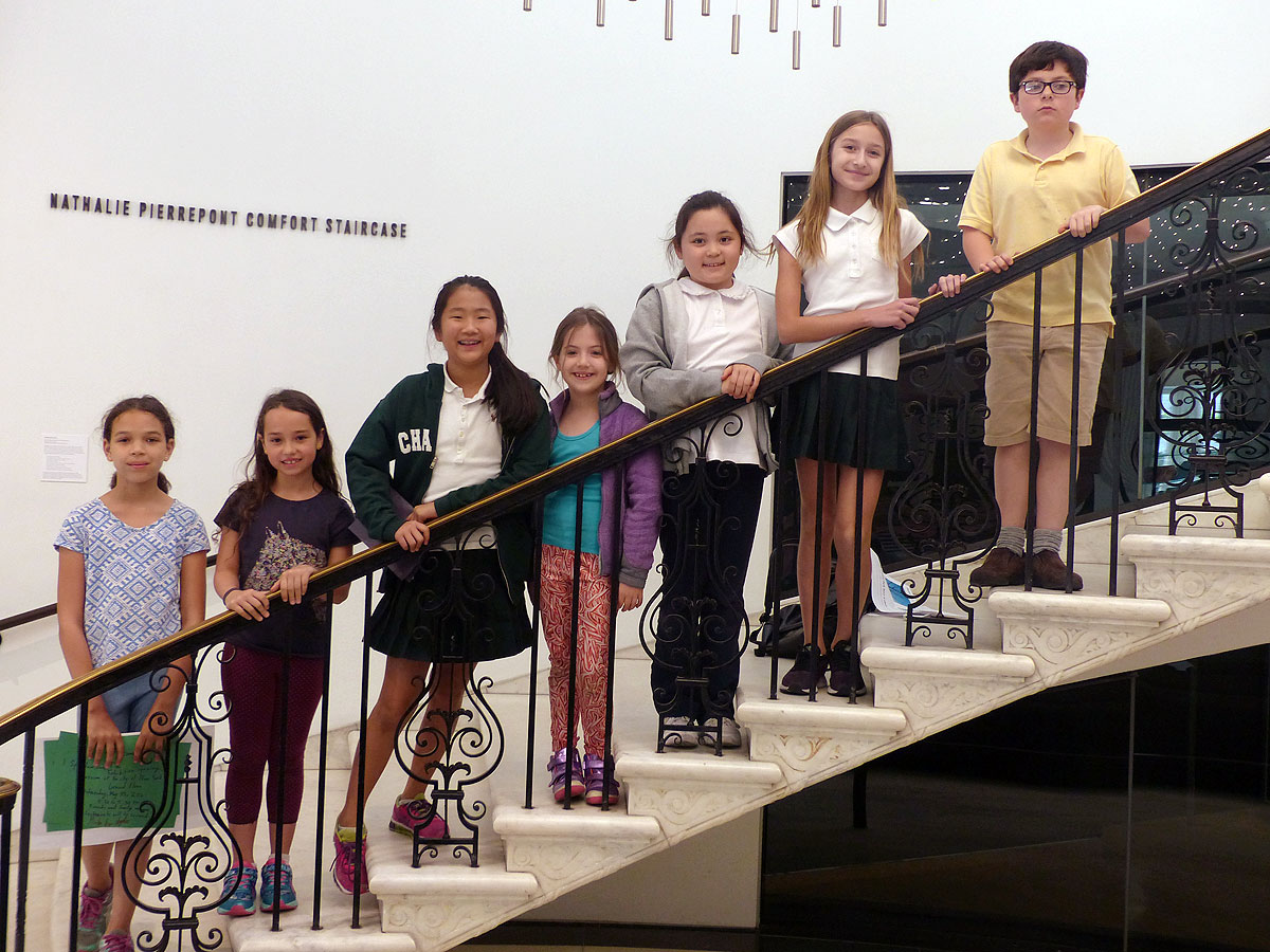 A group of young kids gather on the staircase at the Museum of the City of New York