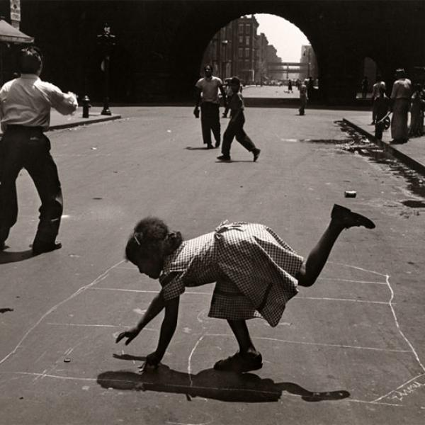 Photograph by Walter Rosenblum of people playing hopscotch on 105th Street near Park Avenue.