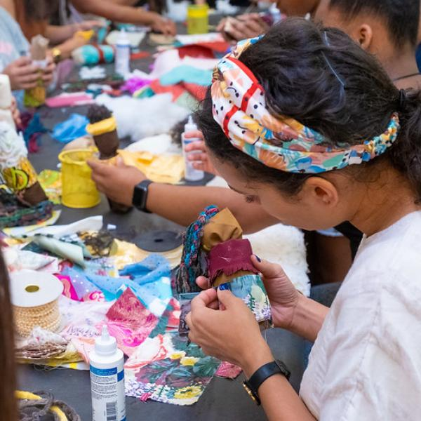 Image features participants at a Black Doll-making Workshop at the Museum.