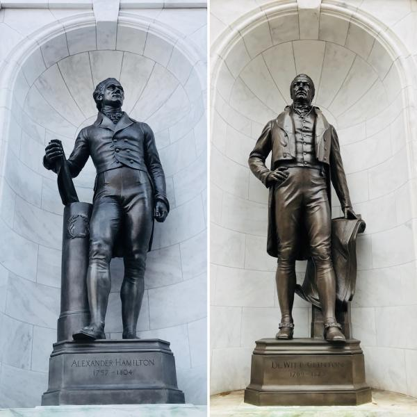 A photo of MCNY statues of Alexander Hamilton and DeWitt Clinton since 1941.