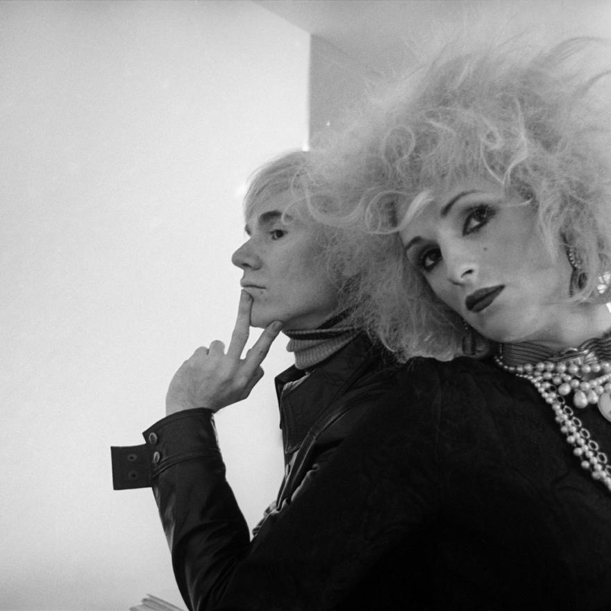 Black and white photograph of Andy Warhol and Candy Darling