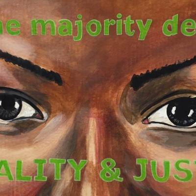 """Painting of a woman's eyes. Painted over her forehead and cheeks are the words """"we the majority demand/EQUALITY & JUSTICE"""""""