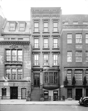 Brownstone surrounded by two other buildings at 14 East 81 Street.