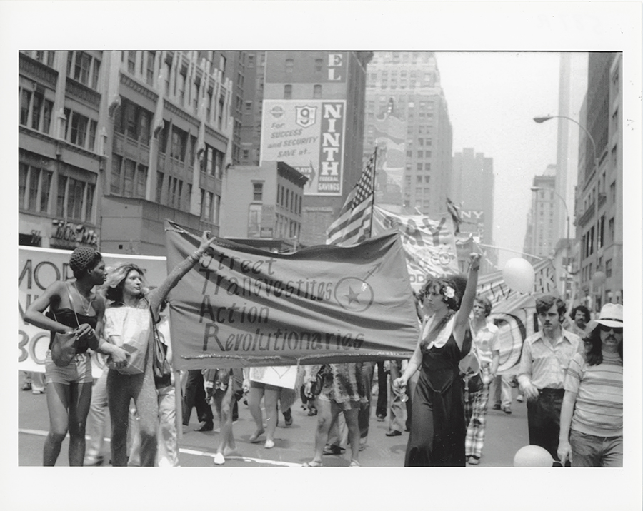 Members of the Street Transvestites Action Revolutionaries hold the group's banner aloft as they join in the 1973 Christopher Street Liberation Day March.