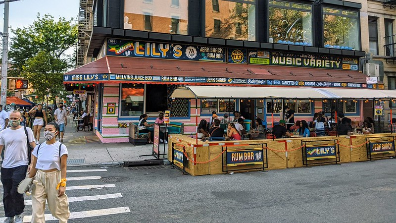 Photo of people eating outside at Miss Lily's Jerk Shack