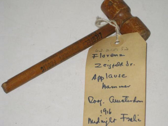 Souvenir – wooden applause hammer from Ziegfeld's Midnight Frolic atop New Amsterdam Theatre, ca. 1916. Museum of the City of New York, 62.215.53