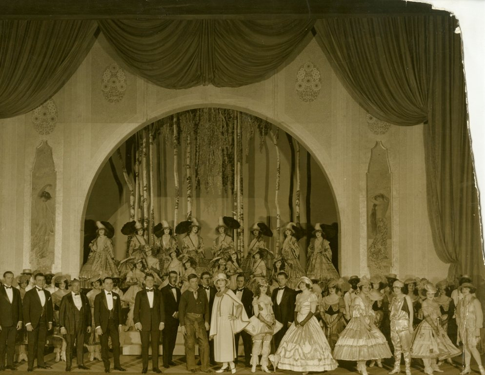 Stage ensemble from the Midnight Frolic with Will Rogers (center), 1917. From the Theater Collection. Museum of the City of New York, 74.92.51