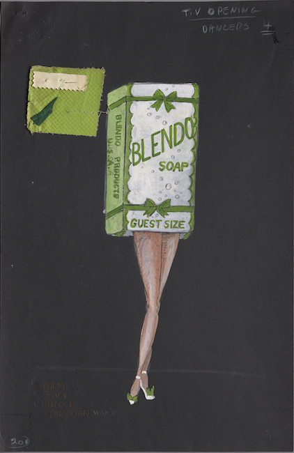 Costume design for a woman with bare legs wearing a soap box that covers her head, arms and torso.  Small green and beige fabric samples attached.