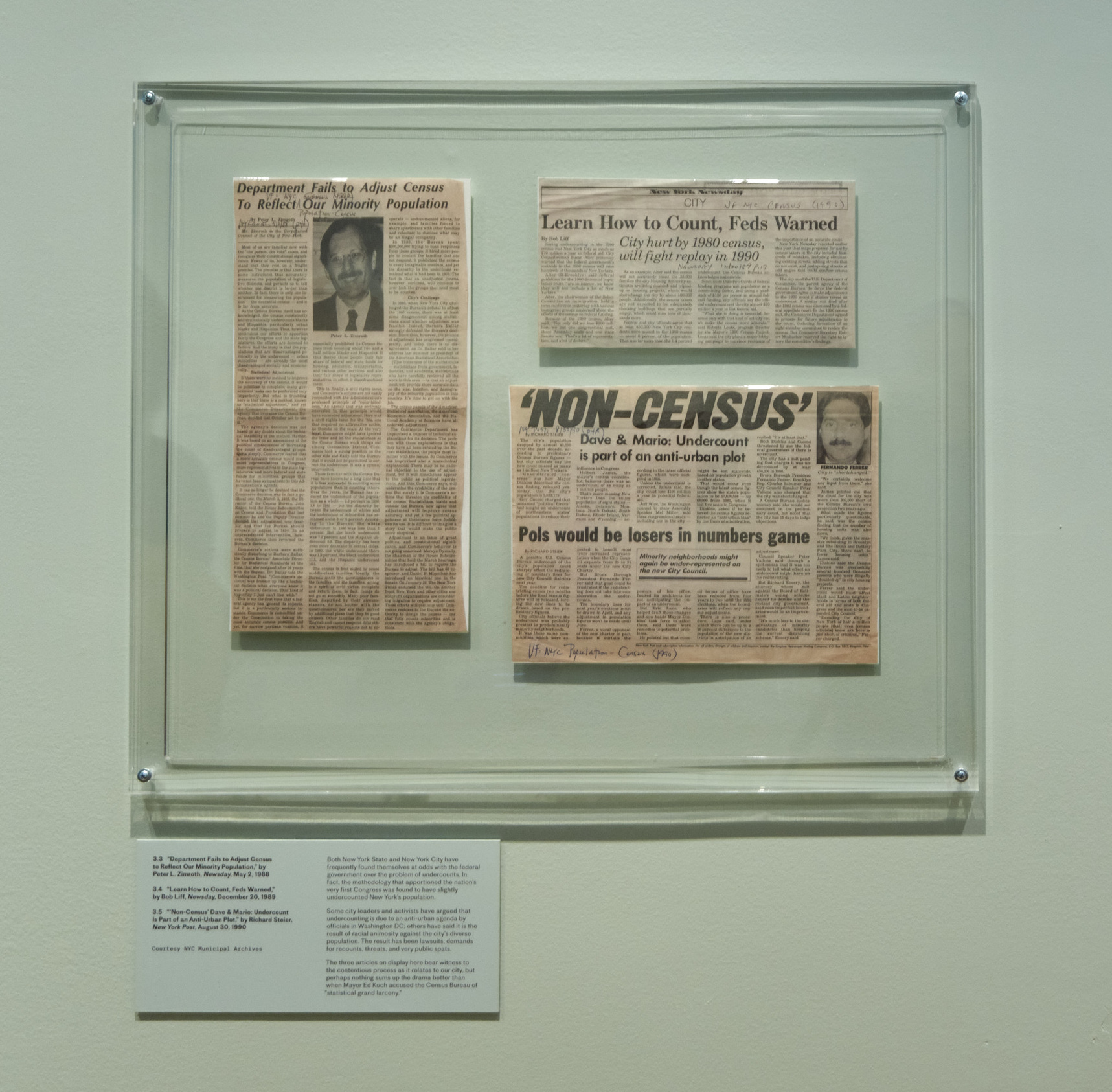 Newspaper clippings with headlines about New York being undercounted in the census.