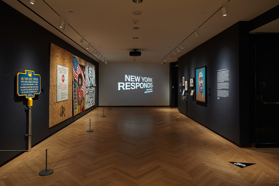 Installation Shot of New York Responds: The First Six Months. View of the anteroom, facing the title wall