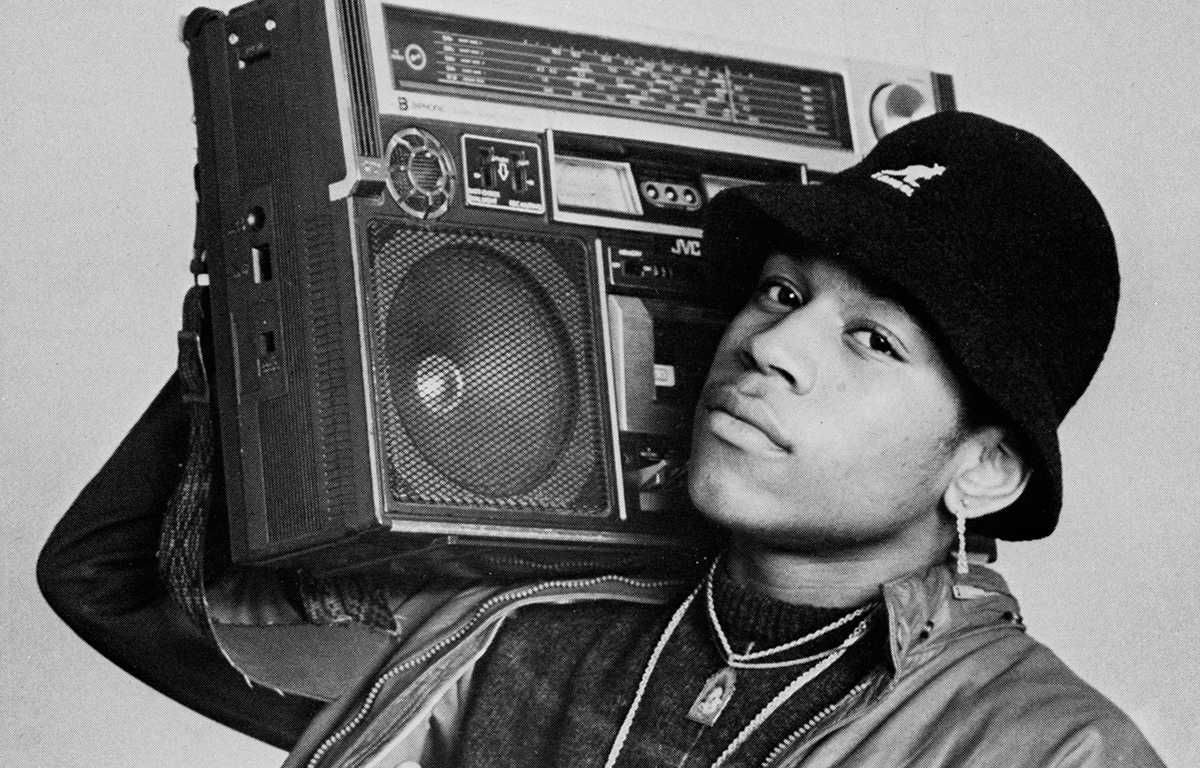 LL Cool J with a boombox on his shoulder.