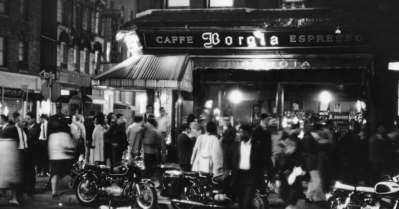 """Fred W. McDarrah, """"Outside the Caffe Borgia, at MacDougal and Bleecker Streets,"""" 1966. Photo © Estate of Fred W. McDarrah. All Rights Reserved."""