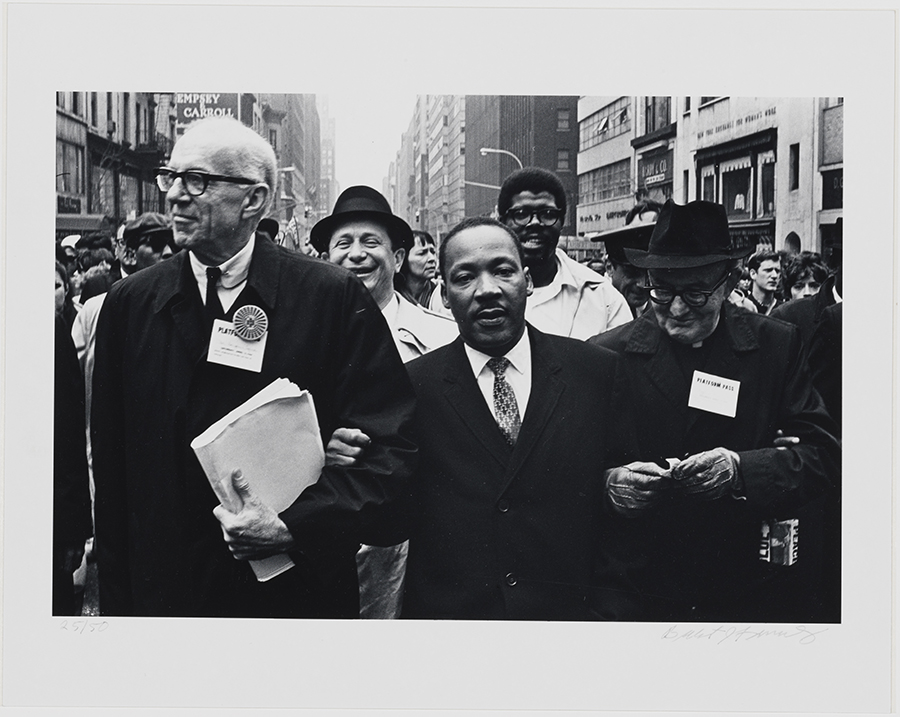 Photograph of Dr. Martin Luther King, Jr., Dr. Benjamin Spock and Monsignor Rice of Pittsburgh at the Solidarity Day Parade in New York City on April 15, 1967.