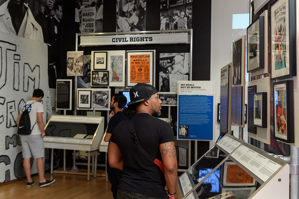 A visitor to the Museum of the City of New York's Activist New York exhibition examines artifacts about the history of social change in the city.