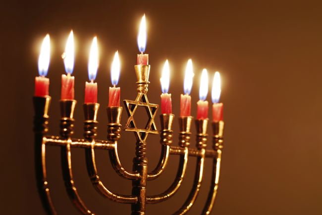 A Hanukkah menorah with all candles lit.
