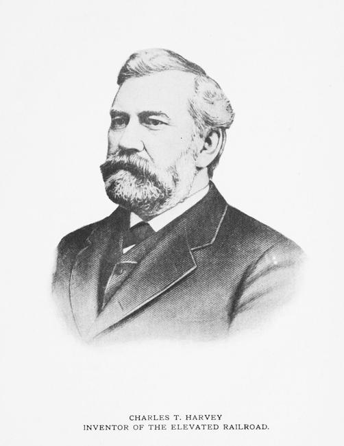 Portrait noir et blanc d'un homme avec une barbe et une moustache en costume-cravate.