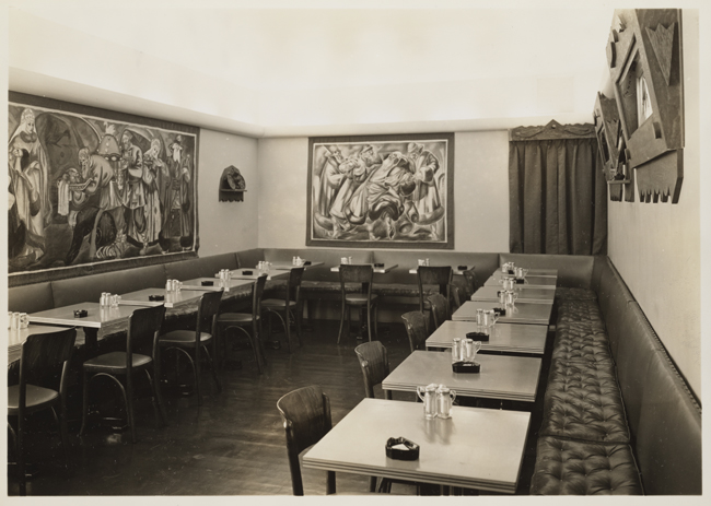 Interior of the Russian Tea Room with dining tables and artwork on the walls.