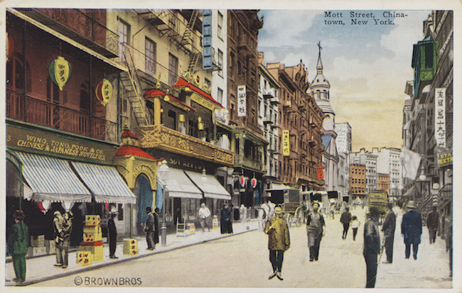 Color postcard depicting buildings and people on Mott Street in Chinatown