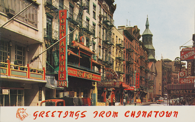 "Color postcard of Mott Street in Chinatown. The words ""Greetings from Chinatown"" are in red on the bottom"