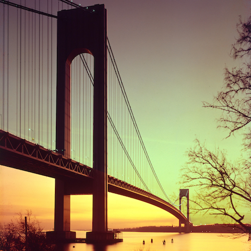 Color photograph of the Verrazano Narrows Bridge at sunset