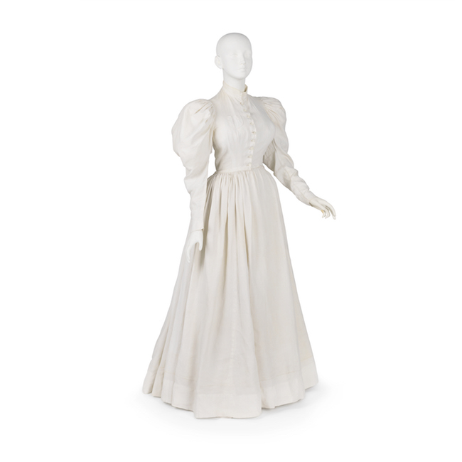Dress of white linen with leg-of-mutton sleeves. Worn as uniform by Lillian D. Wald, founder of the Visiting Nurse Service of N.Y., 1893