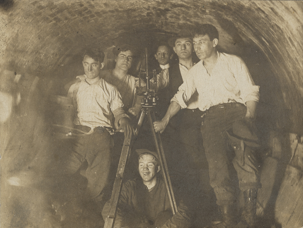 Engineers in tunnel during construction of present IRT at City Hall Station. ca. 1900. Museum of the City of New York. 46.245.2.