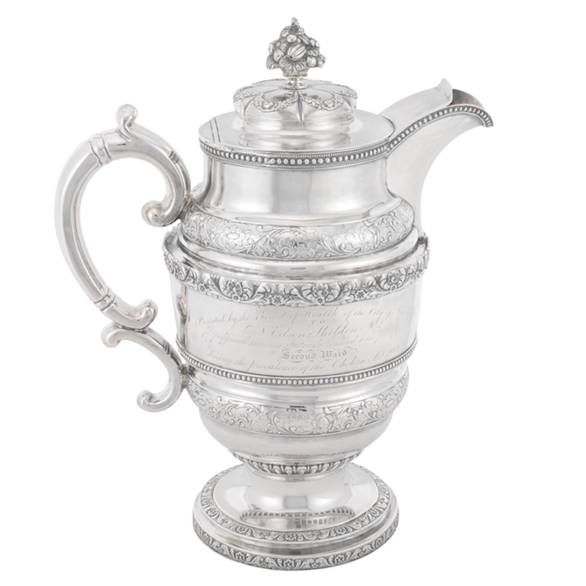 Covered silver ewer with inscription.