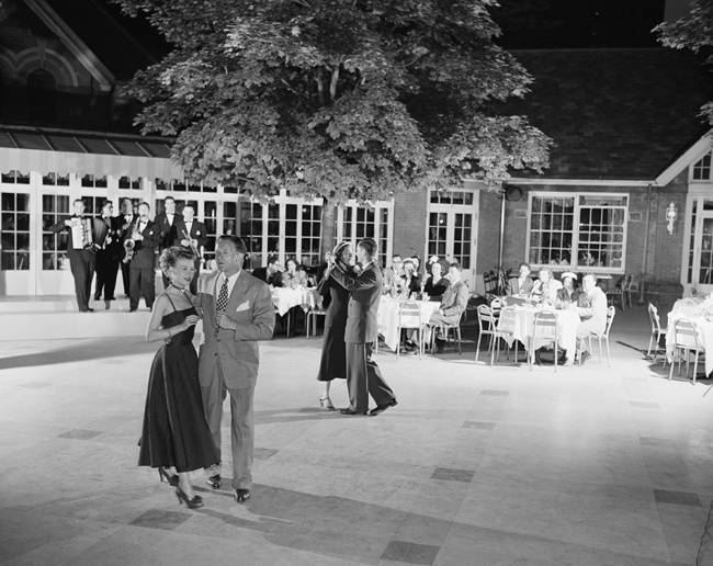 Couples dancing at night on the terrace of Tavern on the Green.