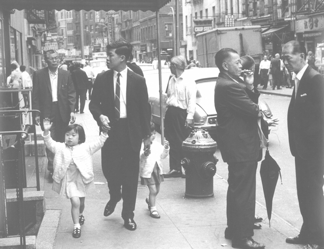 Black and white photo of people on Mott Street