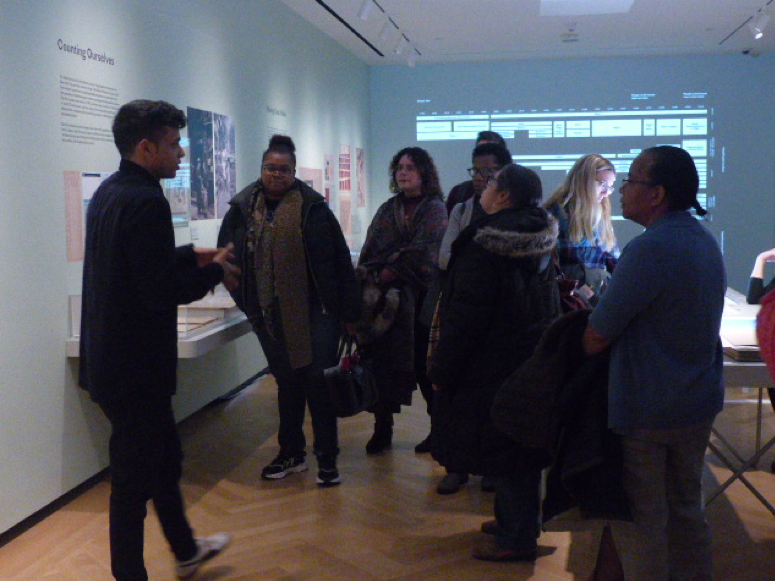 "A group of teachers explore the Museum exhibition ""Who We Are: Visualizing NYC by the Numbers"""