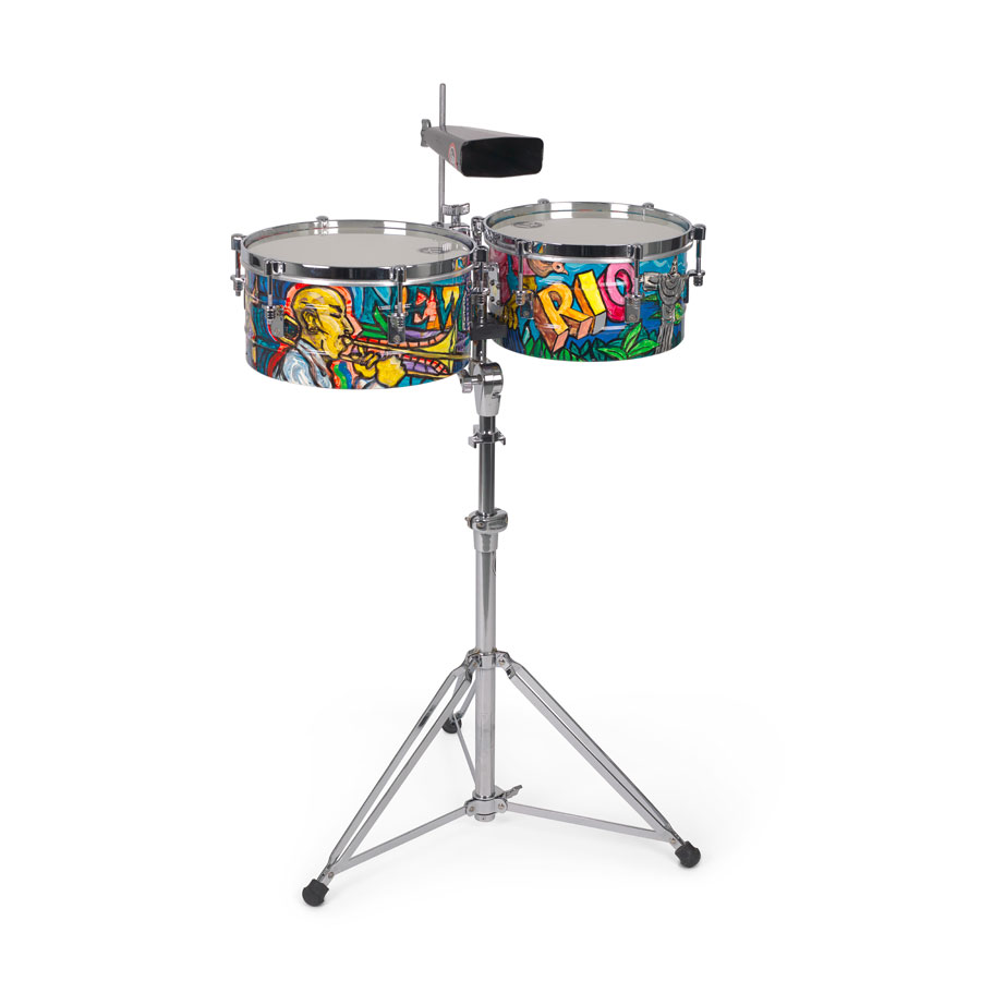 Timbales, high tuned drums with metal casing, and a cowbell. The sides of the timbales are painted in a graffiti-like style