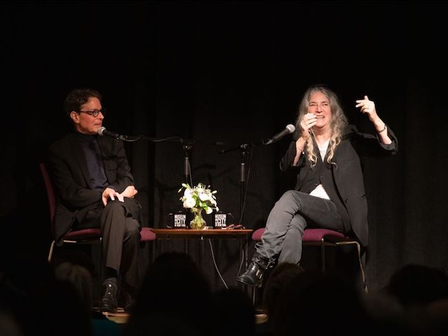 Anthony Alofsin, left, and Patti Smith, right, engage in conversation during a Museum program.