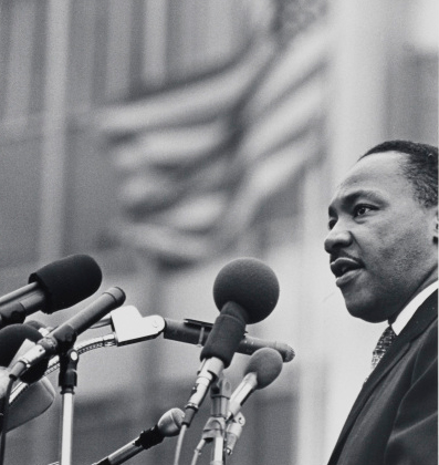A museum photo by Benedict J. Fernandez of [Dr. Martin Luther King, Jr.] during April 15, 1967.