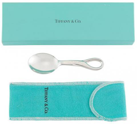 Small sterling silver spoon with wide mouth and looped handle with original flannel bag and box in signature color of Tiffany and Company.