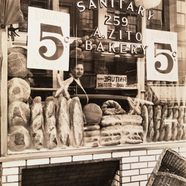 "A museum photo by Berenice Abbott of ""Bread Store"" taken in 1937."