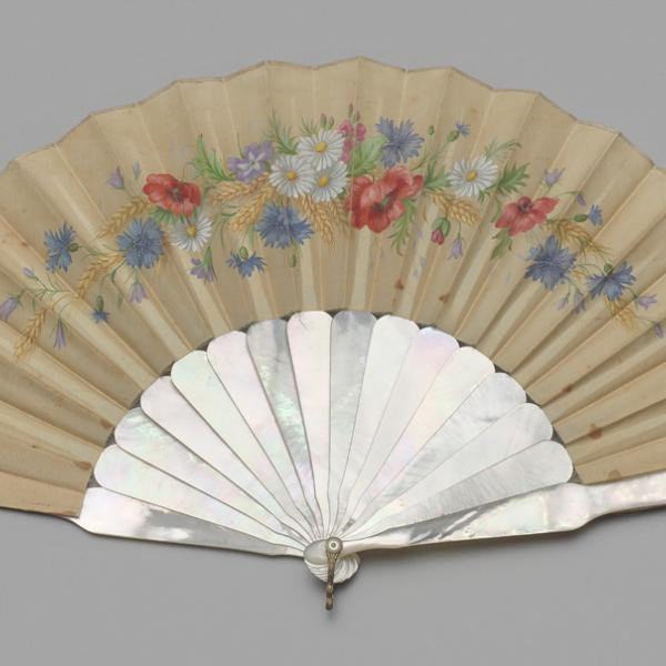 A museum photo of a folding fan of painted chicken skin between 1886-1889.