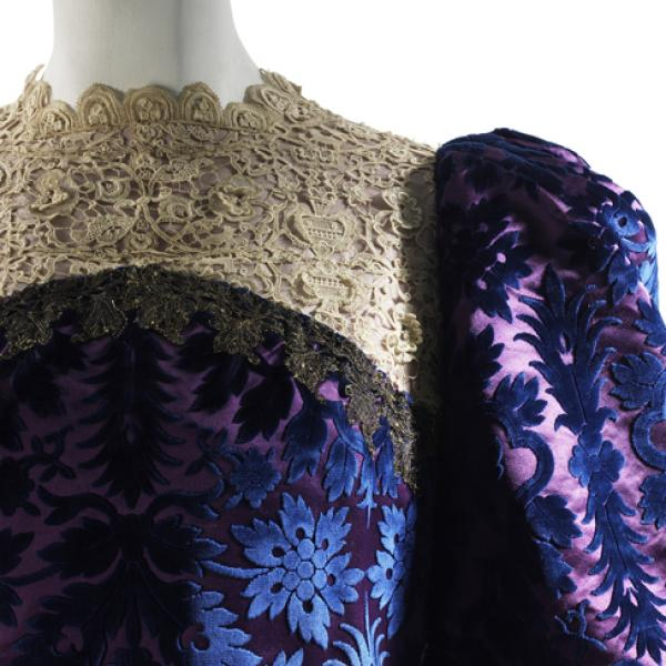 Family garment from the house of Worth. This garment is a tea gown of cut and voided velvet trimmed with lace