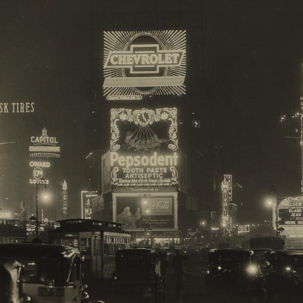 A black and white photograph of New York City at night by Samuel H. Gottscho