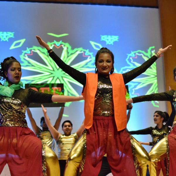 Dancers perform during a Diwali celebration.
