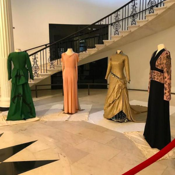 Four dresses which belonged to Marian Anderson, in various colors and styles dressed on mannequins placed in front of the Museum's main staircase.