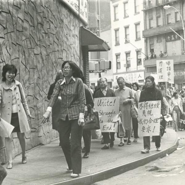 Photograph of protesters marching in Chinatown