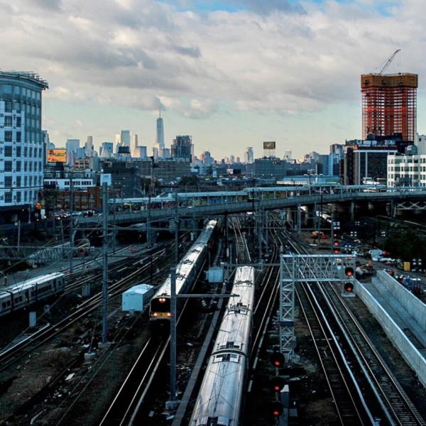 View of New York City overlooking train platform