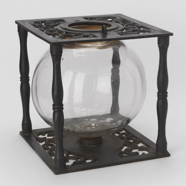 Ballot box with glass globe in cast iron frame.
