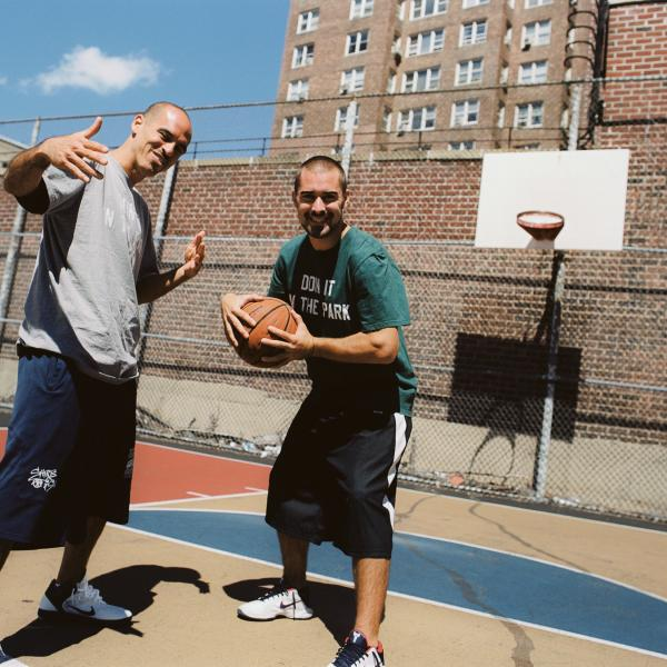 Filmmakers Bobbito Garcia & Kevin Couliau on a basketball court