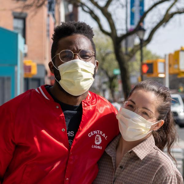 Couple wearing face masks in Brooklyn.
