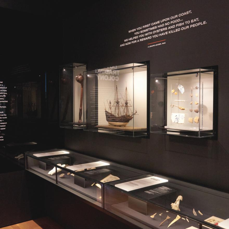 art of an exhibition, includes objects on display and wall text