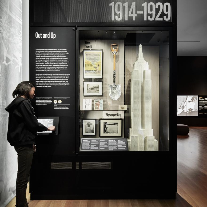 A visitor uses an interactive screen to learn more about the exhibition in front of her