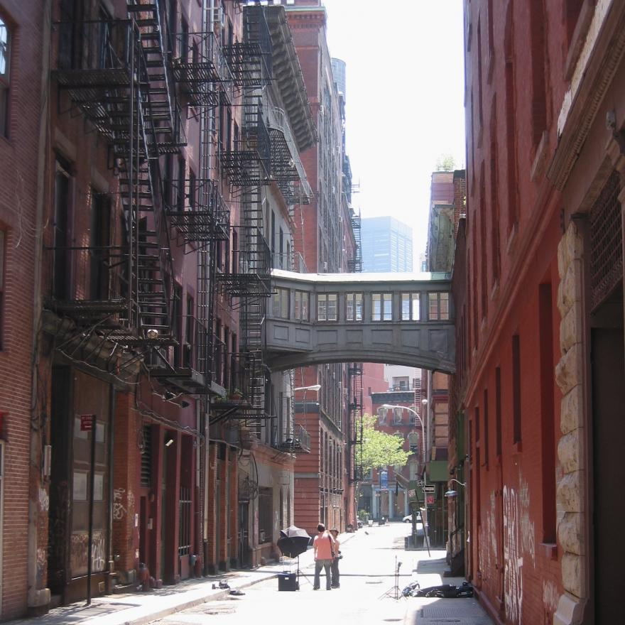 Two people in the middle of a street in Tribeca, NYC