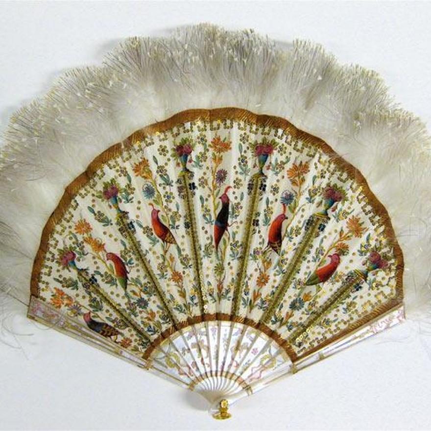 Fan made of white sticks, with detailed birds and flowers painted on the fabric between the ribs, and feathers on the top